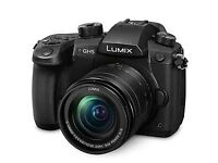 Panasonic GH5 camera with Lumix 12-60mm lens