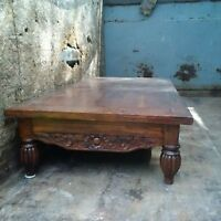 ornately carved coffee table