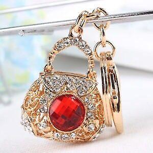 Gold handbag keyring with red sparkling centre