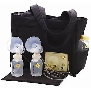 Medela breast pump with bag full of accessories and bottles