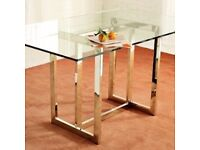 West Elm Glass Top Dining Table Chrome finished steel frame.