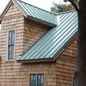 Standing seam metal roofing and custom roof flashings