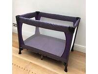 John Lewis travel cot with purple trim