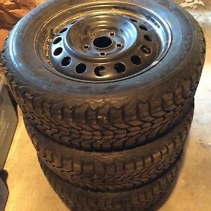 Used Firestone Winterforce Tires with Steel Rims 235/65/16