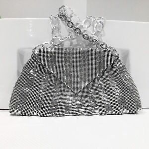 BCBG Max Azria Silver Mesh Evening Bag with Linked Strap.