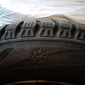 4 WINTER TIRES MOUNTED ON 4 RIMS 215/55R17