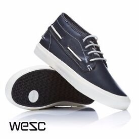 New & boxed WEZC trainer hightop. Navy blue leather upper and rubber sole. UK size 6