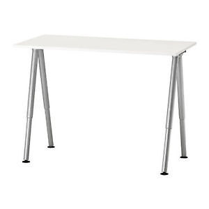 White Ikea desk and black chair