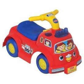 Fisher Price Ride On Fire Engine. Extremely good condition. Flashing lights and siren sounds