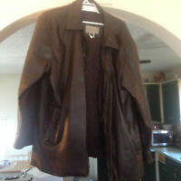 brown leather jacket in mint condition, removeable liner $50.00