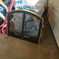 Fireplace glass doors with built in screen attached. Good cond
