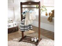 Babies clothes rail .