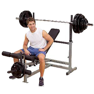 Olympic plates , weight bar and bench
