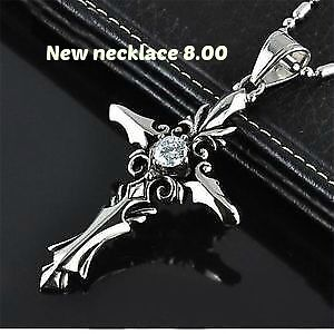 skull wing necklaceand wolf tooth 1 black and 1 blue 2 cross new