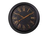 Large metal black wall clock