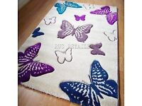 *Large cream butterfly rug*