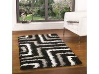 Brand new 160cm x 230cm black/white/grey tides rug