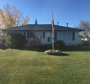 Great 3 Bedroom Bungalow with Fenced Yard and Garage