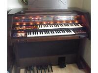 ORLA MANTOVA ORGAN, in perfect imaculate condition with all original manuals and discs