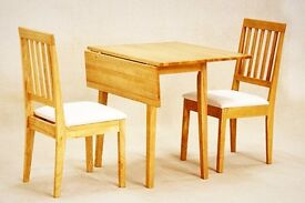 Small extendable oak table with two chairs