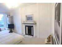 Short term- Master bedroom with super kingsize