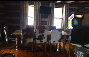 4 very well made cowhide chairs - Take all 4 for $600