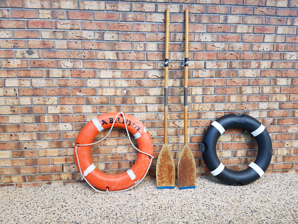 2  LIFE BUOY RINGS  AND OARS