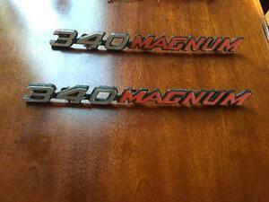 Two 340 magnum emblems