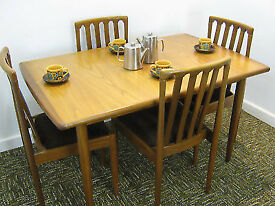 Meredew extendable dining table and four chairs, golden teak.