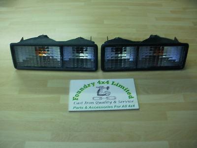 Bearmach Land Rover Discovery 300TDI  Rear Bumper Clear Lamps /& Orange Bulbs x2