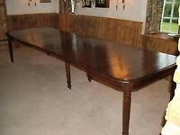 Antique dining table extends to seat 16 or more