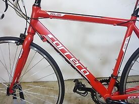 "Carrera Zelos road bike. 14 gears. 21"" Medium frame, very good condition, LED lights."
