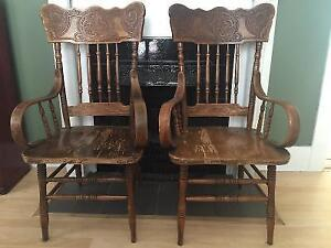 Matching pair of antique wooden Canadian-made Captain's Chairs