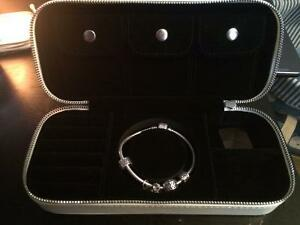 Pandora bracket with case and charms