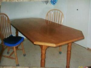 Solid oak table, 6 chairs with cushions. Hutterite made.