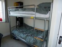 Metal bunk beds with mattresses