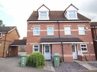 A modern three bedroom, two and a half storey semi-detached house on an attractive development.