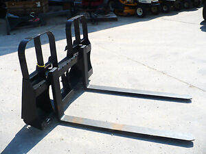 SKID STEER AND TRACTOR PALLET FORKS