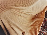Golden faux silk full-length curtains, weighted