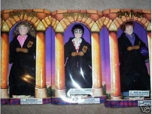 "3 HARRY POTTER GUND DOLLS, AND A HUGE 15"" INCH HAGRID DOLL.  NEW"