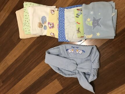 Baby boys muslin wraps and blankets and baby carrier