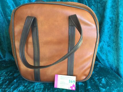 Brown overlocker bag with zip and pocket