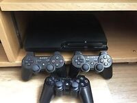 PS3 Slim 160GB, 3 controllers and 33 games