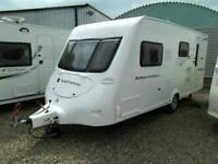 Fleetwood Meridien 520-4EB. 4 berth end bathroom caravan 2008 with full awning and accessories