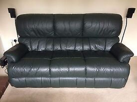 A sit up racing green 3 seater leather sofa