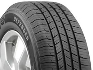 Four Michelin Defender Tires 215/70-16