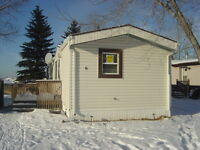 Huge lot comes with this mobile home in MapleRidge/Oakridge
