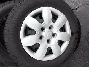 HYUNDAI ELANTRA 15 INCH FACTORY STEEL WHEELS WITH LIKE NEW HIGH PERFORMANCE 195/65/15 ALL SEASON TIRES.