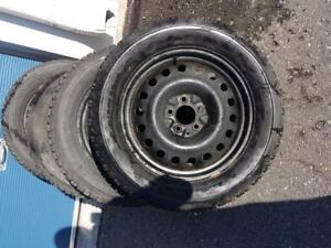 FORD MUSTANG FIRESTONE WINTERFORCE WINTER TIRES 235 / 55 / 17 ON STEEL RIMS.