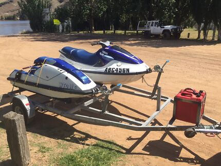 Two JetSkis on double trailer